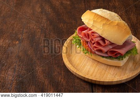 Mortadella Sandwiches Placed On A Wooden Plate Over Rustic Wood, Selective Focus.