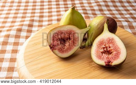 Purple Figs, Purple Figs Open On A Wooden Plate Over Checkered Tablecloth, Black Background, Selecti