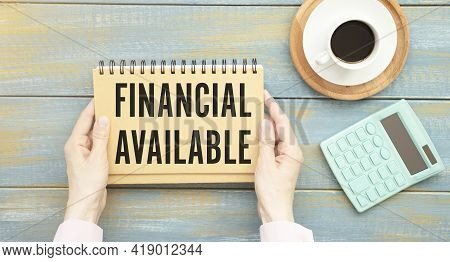 Text Financing Available On Notepad With Office Tools, Pen On Financial Report . Business And Financ