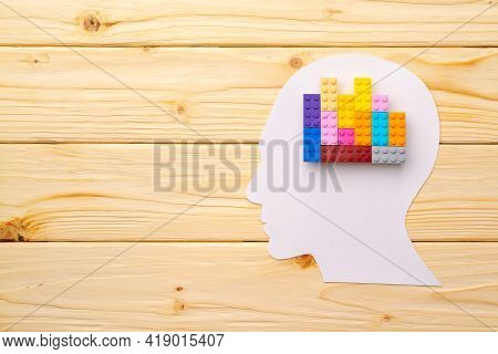 Papercut Silhouette Of Human Head With Colorful Constructor Pieces