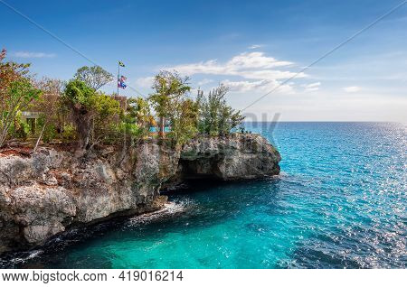 Jamaica Rocky Beach With Turquoise Water In Caribbean Island, Negril, Jamaica
