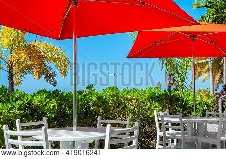 Umbrellas Over Beach Cafe In Caribbean Island In Montego Bay, Jamaica