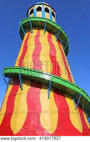 Vintage Red Yellow And Green  Helter Skelter In A Fairground