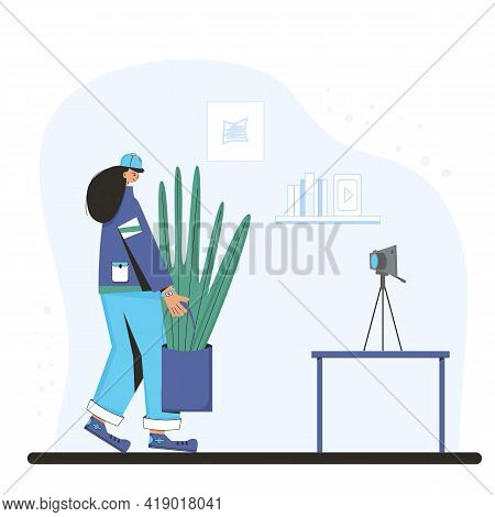 Blogger Recording A New Video. Indoor Plants Lovers. Person Wearing In Casual Clothes Holding In Han