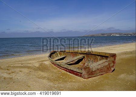 Old Boat Cape Kazantip Summer. Shipwreck On A Beach.
