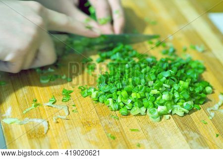 Chopping Green Onions For Salad For Dinner, A Person Chopping Green Onions With A Knife,