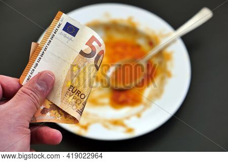 Food Waste, Waste Of Food In The World, Dollar, Euro And Lira Banknotes On The Floor,