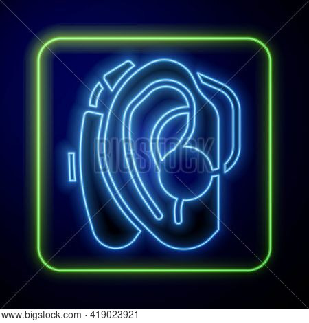 Glowing Neon Hearing Aid Icon Isolated On Blue Background. Hearing And Ear. Vector