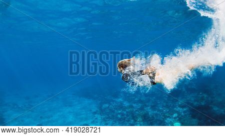 Happy Family - Active Teenage Girl Jump And Dive Underwater In Tropical Coral Reef Pool. Travel Life