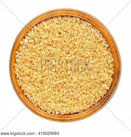 Coarse Demerara Sugar In A Wooden Bowl. Crystalline Natural Raw Sugar, A Sucrose Sugar With Distinct