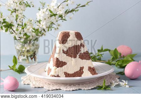 Traditional Easter Orthodox Curd Dessert With Chocolate And Colorful Eggs On Light Blue Background.