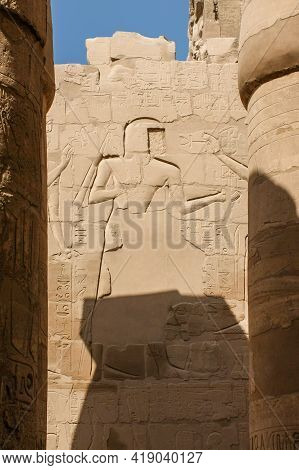 Karnak Temple Complex In Luxor, Egypt. An Ancient Bas-relief With Hieroglyphics On The Wall, Pharaoh