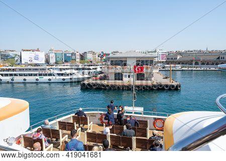 Kadikoy, Istanbul, Turkey - 04.29.2021: Ferry Ship Approaches Kadikoy Ferry Terminal Pier With Blue