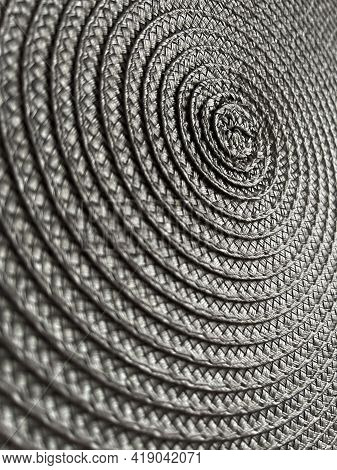Background From Circular Wicker Pattern Texture. Grey Weave Texture.