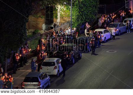 Thessaloniki, Greece - May 01 2021: Orthodox Easter 2021 Anastasi Resurrection. Faithful Wearing Fac