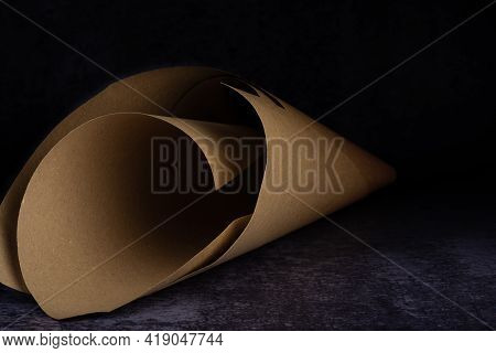 A Paper Cone On A Dirty Light And Dark Blue Background