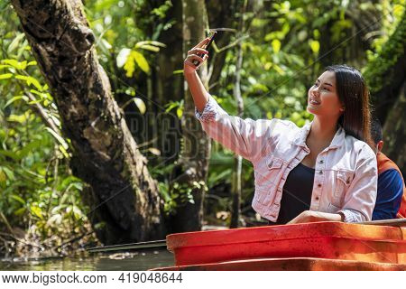 Activity And Technology Concept. Traveler Young Woman Using Smartphone Taking Photo While Sitting On