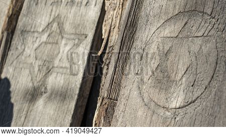 Unique Wooden Jewish Matzevah. Jewish Tombstone. Old Jewish Cemetery In The Forest.