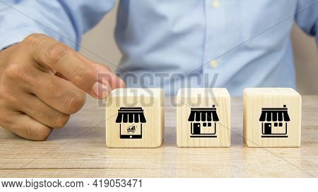 Franchise, Close-up Hand Choosing Cube Wooden Blocks Stack With Franchise Business Store E-commerce