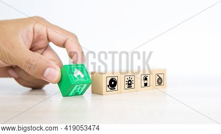 Close-up Hand Choose Fire Prevent Symbol On Wooden Toy Block Stacked With Door Exit Sing Or Fire Esc