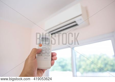 Close Up Remote Set Adjust Temperature At 25 Degrees Of Air Conditioner Split Type Wall Mounted In H