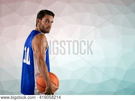 Composition of basketball player holding basketball over textured surface. sport and competition concept digitally generated image.