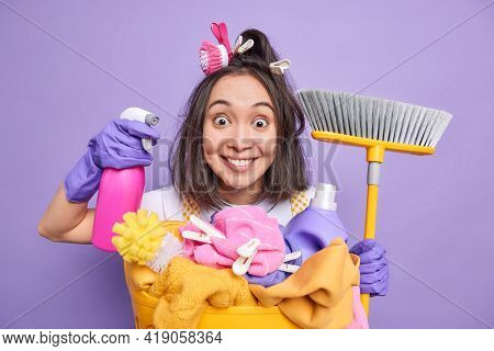 Cleanup And Washing Time Concept. Cheerful Surprised Young Asian Woman Poses With Dispenser And Broo
