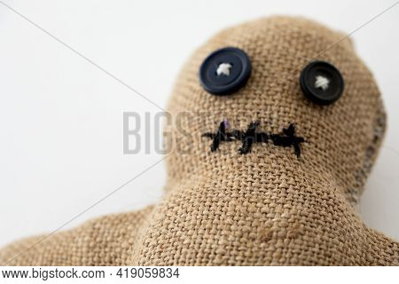 Handmade Voodoo Doll. Craft And Hobby Concept. Object On A White Background.