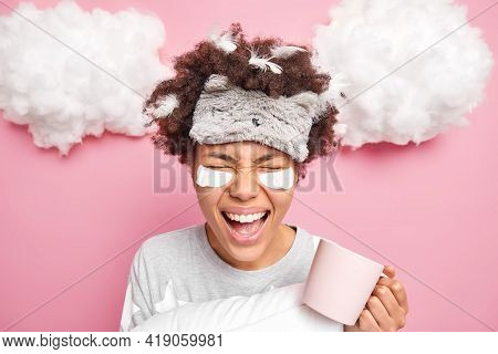 Emotional Woman Has Curly Afro Hair With Stuck Feathers Screams Loudly Enjoys Drinking Morning Coffe