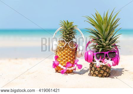 Summer In The Party.  Hipster Pineapple Fashion In Sunglass And Listen Music With Sunblock And Sanda