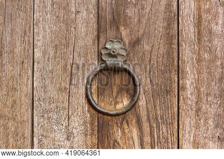 Old Dark Wooden Door With Iron Handles