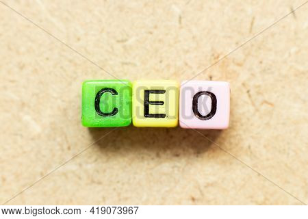 Color Alphabet Letter Block In Word Ceo (abbreviation Of Chief Executive Officer) On Wood Background