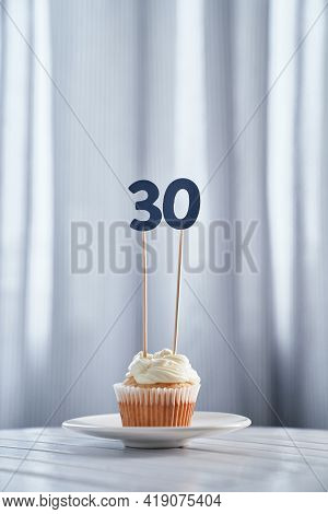 Digital Gift Card Concept. Tasty Homemade Vanilla Anniversary Or Birthday Cupcake With Creamy Toppin