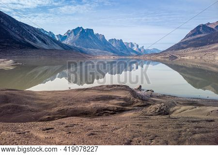 Granite Rock Peaks Reflect In Waters Of Glacier Lake In Remote Arctic Valley Of Akshayuk Pass, Baffi