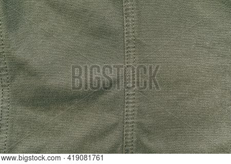 Old Used Dark Green Military Cotton Fabric Texture, Grunge, Rough, Dirty Background. Sun Bleached Or