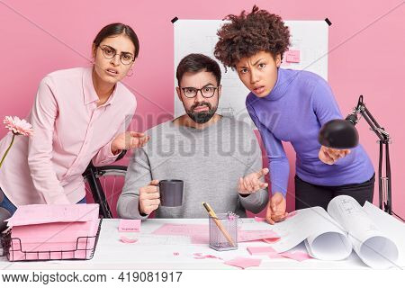 Professional Team Of Architects Collaborate On Engineering Project Look Puzzled And Hesitant Try To