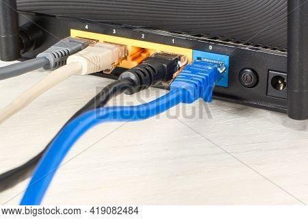 Home Wi-fi Router For Internet Connection With Four Patch Cords With Rj45. Concept Home Network, Clo