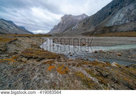 A Cloudy, Rainy Day In Remote Arctic Valley Of Akshayuk Pass, Baffin Island, Canada. Hiking Far Nort