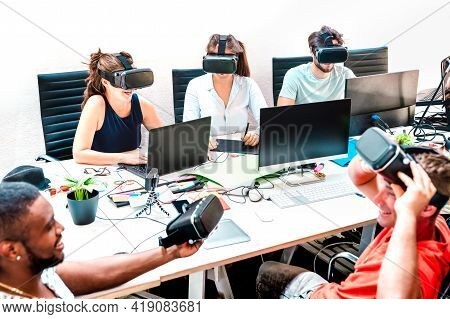 Young People Employee Workers Having Fun With Vr Virtual Reality Goggles In Startup Office - Human R