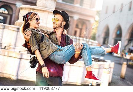 Hipster Couple In Love Having Genuine Fun Wandering At City Center - Wanderlust Life Style And Trave