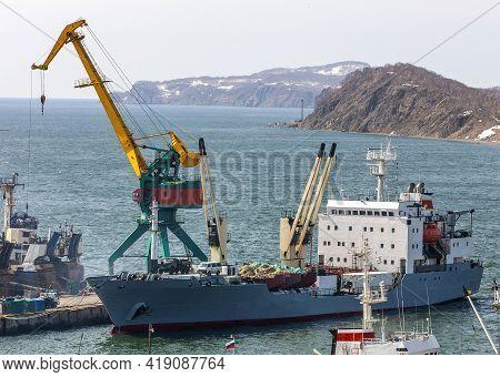 Ships At Pier, Port Cranes On Commercial Seaport Petropavlovsk-kamchatsky City On Shore Of Avacha Ba