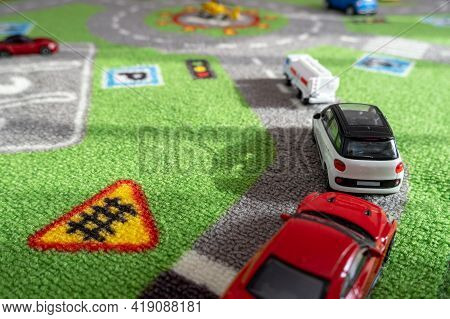 Toy Cars On An Urban Carpet For Children - As An Urban Transport Concept