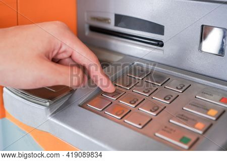 Press Atm Pin, Finger Entering Pin Pass Code On Bank Machine Keypad. Automated Teller Machine Is Ele