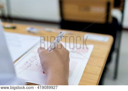 Education School Test Concept : Hands Student Holding Pencil For Testing Exams Writing Answer Sheet