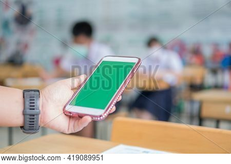 Mock Up Green Screen Smart Phone, Application Digital Smartphone On Exam Testroom While Students Sch