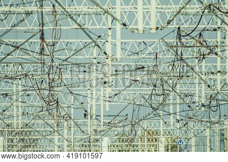 Electric Railroad Masts Traction Power. Registration Arms And High Voltage Wiring Infrastructure. Fe