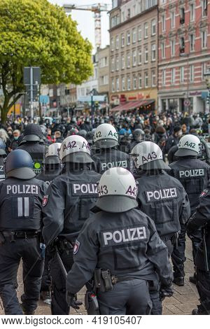Hamburg, Germany - May 1, 2021: German Riot Police On The Side Of A Demonstration With Helmets On Du