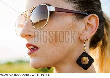 Portrait Of A Young Woman With Freckles Close-up. Freckled Girl In Sunglasses.