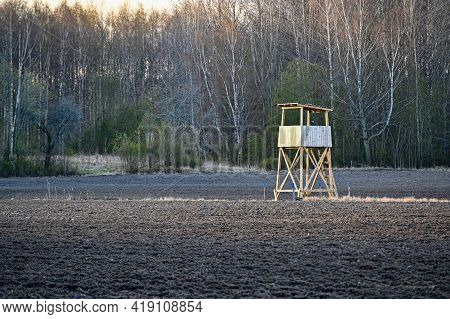 Hunting Tower Standing In A Agriculture Field