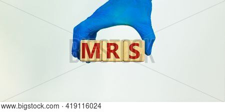 Medical And Mrs Menstrual Related Symptoms Symbol. Doctor Holds Wooden Blocks With The Word 'mrs'. B